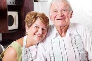 happy senior couple portrait in home kitchen